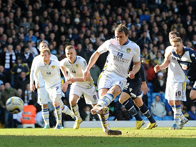Leeds' Stephen Warnock scores a penalty against Millwall on March 2, 2013