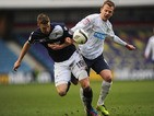 Millwall's Mark Beevers and Blackburn's Jordan Rhodes battle for the ball on March 10, 2013