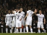 Spurs players congratulate Gylfi Sigurdsson following his goal against Inter Milan on March 7, 2013