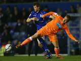 Birmingham City's Jonathan Spector and Blackpool's Angel Martinez battle for the ball on March 5, 2013