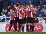 Sunderland players celebrate with goalscorer Steven Fletcher after he scored the opening goal in his side's match with QPR on March 9, 2013