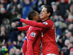 Javier Hernandez is congratulated by team mate Patrice Evra after scoring the opening goal against Chelsea in the FA Cup quarter final on March 10, 2013
