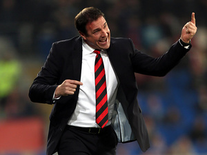 Cardiff boss Malky Mackay gestures to his team during the match against Derby on March 5, 2013