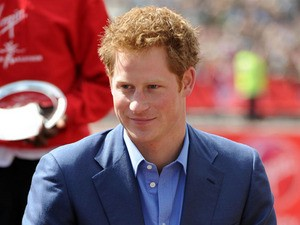 Prince Harry presents awards during the 32nd Virgin London Marathon in London on April 22, 2012