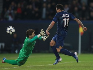 Paris Saint-Germain's Ezequiel Lavezzi scores against Valencia during their Champions League last 16 tie on March 6, 2013