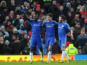Ramires is congratulated by team mates Oscar and Juan Mata after scoring the equaliser against Manchester United in the FA Cup quarter final on March 10, 2013