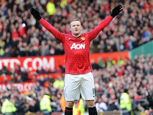 Wayne Rooney celebrates after scoring his team's second goal from a free-kick against Chelsea in the FA Cup quarter final on March 10, 2013