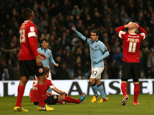 Manchester City's Carlos Tevez celebrates scoring his hat trick in his side's FA Cup match with Barnsley on March 9, 2013