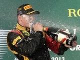 Lotus driver Kimi Raikkonen celebrates with champagne after winning the Australian Formula One Grand Prix on March 17, 2013