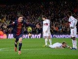 Barcelona's Lionel Messi celebrates after scoring his second goal against AC Milan on March 12, 2013