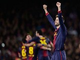 Barcelona player Gerard Pique celebrates after his side knocked AC Milan out of the Champions League on March 12, 2013