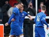 Rangers' players celebrate Lee McCulloch's goal against Elgin City on March 16, 2013