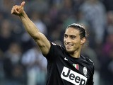 Juventus defender Martin Caceres gives a thumbs up after his side's Seria A match against Napoli on October 20, 2012