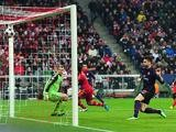 Olivier Giroud scores the opening goal against Bayern Munich on March 13, 2013