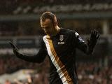 Fulham's Dimitar Berbatov celebrates scoring against Tottenham on March 17, 2013
