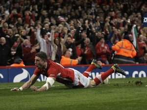 Wales' Alex Cuthbert scores a try against England during the Six Nations game on March 16, 2013