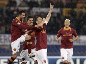 Roma captain Francesco Totti celebrates a goal against Parma on March 17, 2013