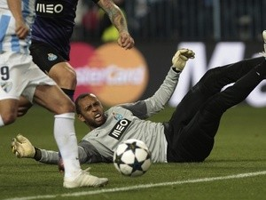 Porto 'keeper Helton lays stranded on the floor during a game with Malaga on March 13, 2013