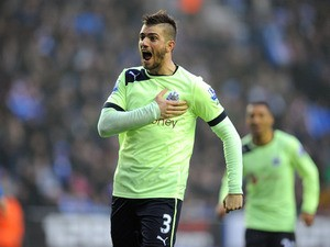 Newcastle United's Davide Santon celebrates scoring against Wigan Athletic on March 17, 2013