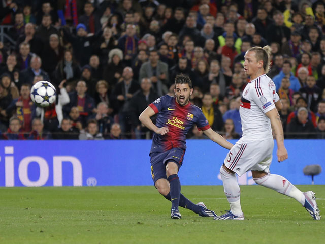 Barcelona's David Villa scores his side's third goal in their Champions League clash with AC Milan on March 12, 2013