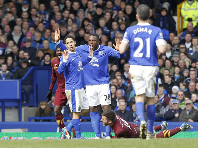 Everton's Steven Pienaar is sent off for a foul on Manchester City's Francisco Javi Garcia on March 16, 2013