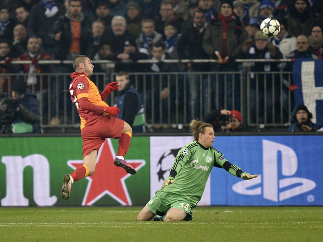 Galatasaray's Burak Yilmaz scores past Schalke goalkeeper Timo Hildebrandon March 12, 2013