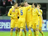 Ukraine players celebrate following a goal in their match against Poland on March 22, 2013