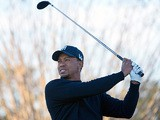 Tiger Woods hits a shot from the 10th during the first round of the Arnold Palmer Invitational tournament on March 21, 2013
