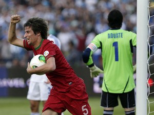 Portugal's Fabio Coentrao celebrates scoring against Israel during the World Cup qualifying match on March 22, 2013