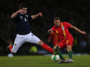 Wales' Craig Bellamy battles for the ball with Scotland's Grant Hanley during the World Cup qualifiying match on March 22, 2013