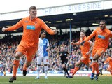 Blackpool's Gary Mackenzie celebrates scoring against Blackburn in the Championship match on March 29, 2013