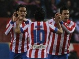 Athletico Madrid striker Radamel Falcao is congratulated following a goal against Valencia on March 31, 2013