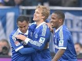 Schalke's Raffael is congratulated by team mates after scoring his team's second against Hoffenheim on March 30, 2013