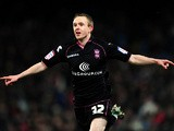 Birmingham's Shane Ferguson celebrates moments after scoring his team's fourth against Crystal Palace on March 29, 2013
