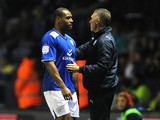 Leicester's Wes Morgan is consoled by manager Nigel Pearson after being sent off against Millwall on March 29, 2013