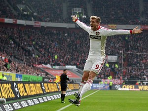 Leverkusen's Andre Schuerrle celebrates after scoring his team's second against Fortuna Dusseldorf on March 30, 2012