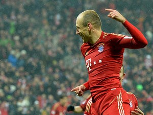 Munich's Arjen Robben celebrates after scoring his team's fourth against Hamburger SV on March 30, 2013