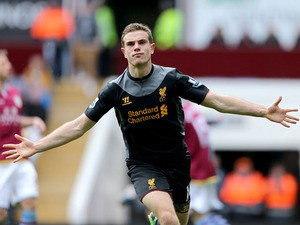 Liverpool's Jordan Henderson celebrates scoring against Aston Villa on March 31, 2013