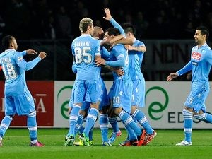 Napoli's Blerim Dzemaili is mobbed by team mates after scoring the opener against Torino on March 30, 2013