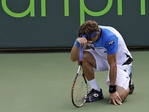 Spaniard David Ferrer reacts to losing a challenge at the Miami Masters Final on March 31, 2013