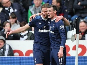 Gareth Bale is congratulated by team mate Jan Vertonghen after scoring his team's second against Swansea on March 30, 2013