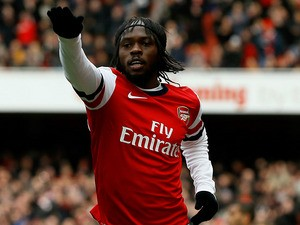 Gervinho celebrates scoring the opening goal against Reading on March 30, 2013