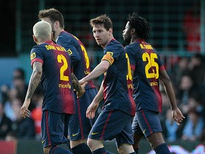 Barcelona's Lionel Messi is congratulated by team mates after scoring his team's second against Celta Vigo on March 30, 2013