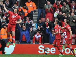 Rickie Lambert is joined by team mates as he celebrates scoring his team's second against Chelsea on March 30, 2013