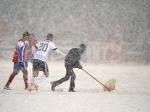 Groundsman removes snow during the USA verses Costa Rica World Cup Qualifying match on March 22, 2013