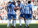 Brighton's Kazenga LuaLua celebrates scoring a late equaliser in his side's match against Leicester on April 6, 2013