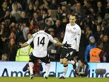 Dimitar Berbatov is congratulated by team mate Giorgos Karagounis after scoring his second against QPR on April 1, 2013