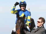 Ryan Mania celebrates on Auroras Encore after winning the John Smith's Grand National Chase on April 6, 2013