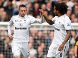 Gylfi Sigurdsson is congratulated by team mate Tom Huddlestone after scoring a late equaliser against Everton on April 7, 2013