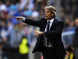 Malaga coach Manuel Pellegrini gestures during his side's Champions League match against Borussia Dortmund on April 3, 2013